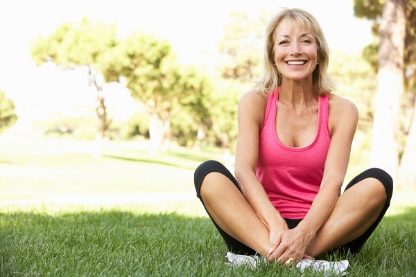 Healthy woman sitting on the ground