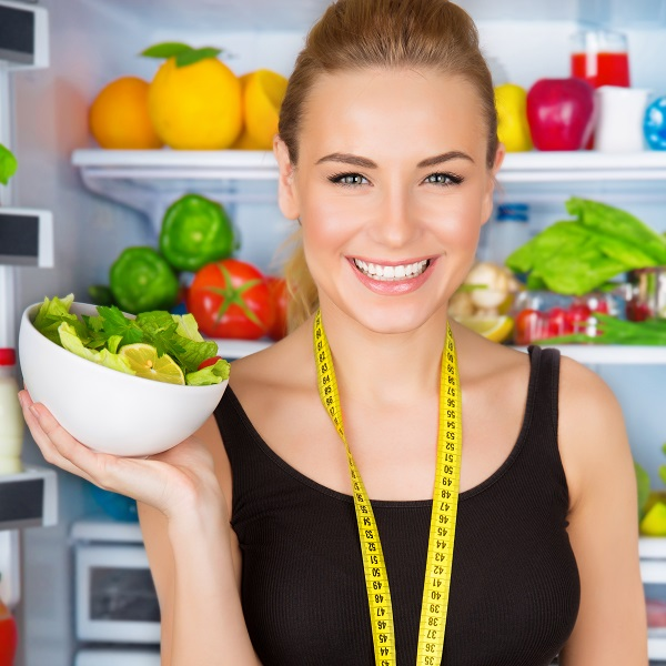 Young woman holding a salad
