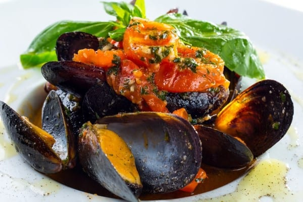 Recipe:  Clams with Smoky Bacon and Tomatoes